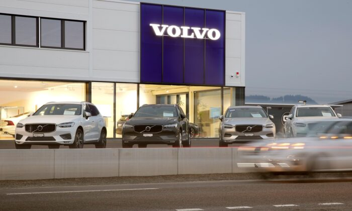 A long exposure picture shows cars of Swedish automobile manufacturerVolvodisplayed in front of a showroom of Stierli Automobile AG company in St. Erhard, Switzerland April 11, 2019. (Arnd Wiegmann/Reuters)