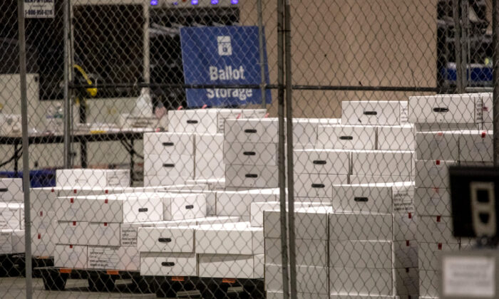 Boxes of counted ballots are seen locked in the ballot storage area at the Philadelphia Convention Center in Philadelphia, Pa., on Nov. 6, 2020. (Chris McGrath/Getty Images)