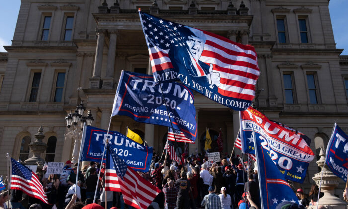 Supporters of U.S. President Donald Trump rally at the State Capitol in Lansing, Mich., on Nov. 7, 2020, (Seth Herald/AFP via Getty Images)