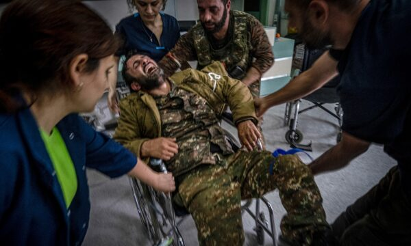 A soldier is taken into a hospital