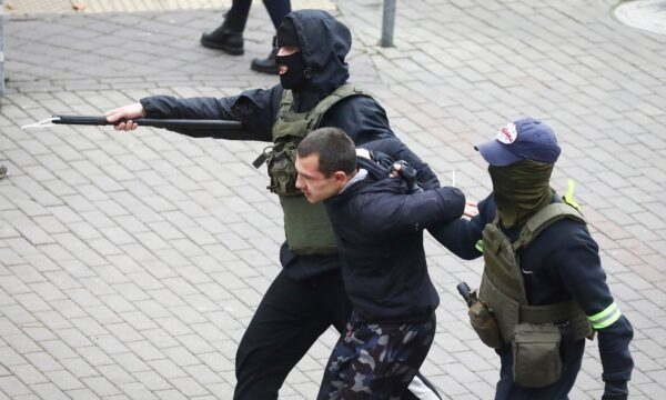 Police detain a man