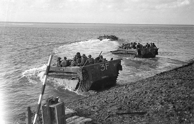 """Buffalo"" amphibious vehicles taking troops of the Canadian First Army across the Scheldt in Holland, September 1944. (Public domain)"