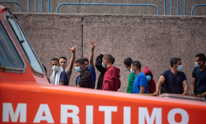Migrants from a group of 1300 rescued from different boats remain in the port of Arguineguin while being cared for by the Spanish Red Cross and the National Police on the Spanish Canary island of Gran Canaria, on Oct. 25, 2020. (Desiree Martin/AFP via Getty Images)