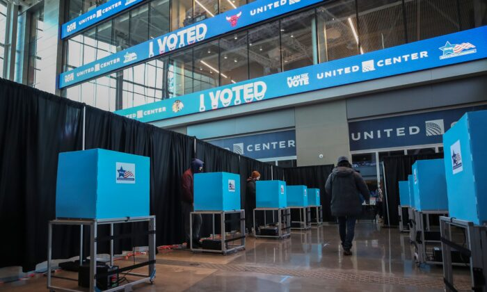 People cast their ballots at the United Center on Election Day in Chicago, Ill., on Nov. 3, 2020. (Kamil Krzaczynski/AFP via Getty Images)