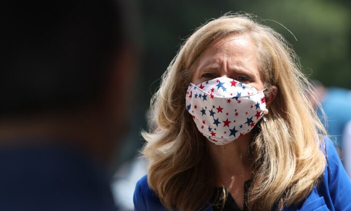 Rep. Abigail Spanberger (D-Va.) waits in line to vote at the Henrico County Registrar's office in Henrico, Va., on Sept. 18, 2020. (Win McNamee/Getty Images)