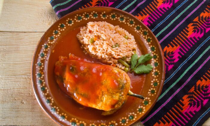 Chiles rellenos are traditionally stuffed, coated with a stiff egg mixture, deep-fried, and served with a fresh tomato sauce. (Guajillo Studio/Shutterstock)