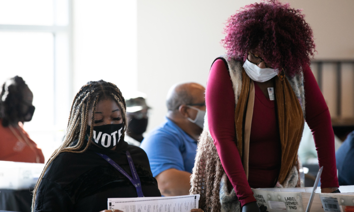Fulton county workers continue to count absentee ballots at State Farm Arena in Atlanta, Ga., on Nov. 6, 2020. (Jessica McGowan/Getty Images)