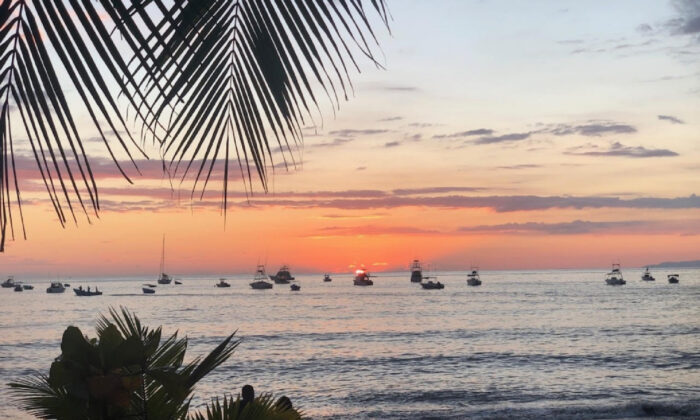 The sun sets over Puntarenas on the Pacific side of Costa Rica. (Courtesy of Bill Neely)