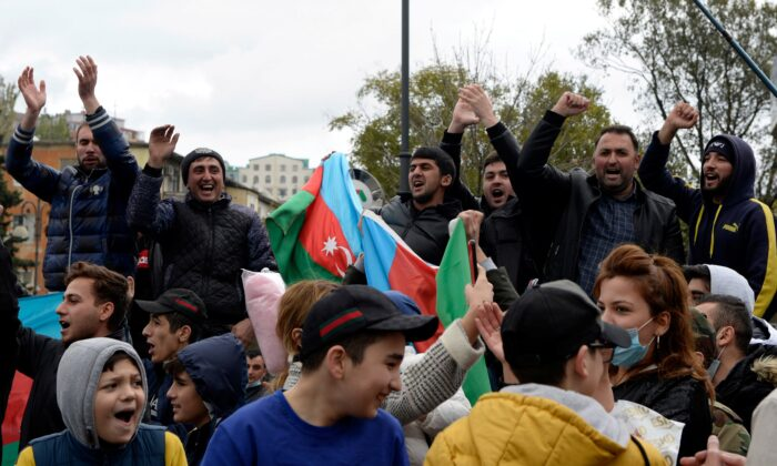 People celebrate on the streets after Azerbaijan's President Ilham Aliyev said the country's forces had taken Shusha, which Armenians call Shushi, during the fighting over the breakaway region of Nagorno-Karabakh, in Baku, Azerbaijan, on Nov. 8, 2020. (Stringer/Reuters)