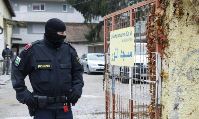 A police officer stands guard outside a property following an anti-terror raid, in Graz, Austria, on Nov. 9, 2020. (Erwin Scheriau/APA/AFP via Getty Images)