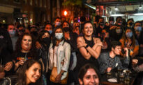 Biden Campaign Urges People to Wear Masks, Social Distance Amid Packed Celebrations