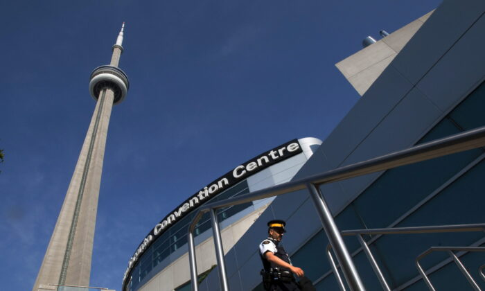 An RCMP officer patrols outside the Metro Toronto Convention Centre on June 25, 2010. (The Canadian Press/Frank Gunn)