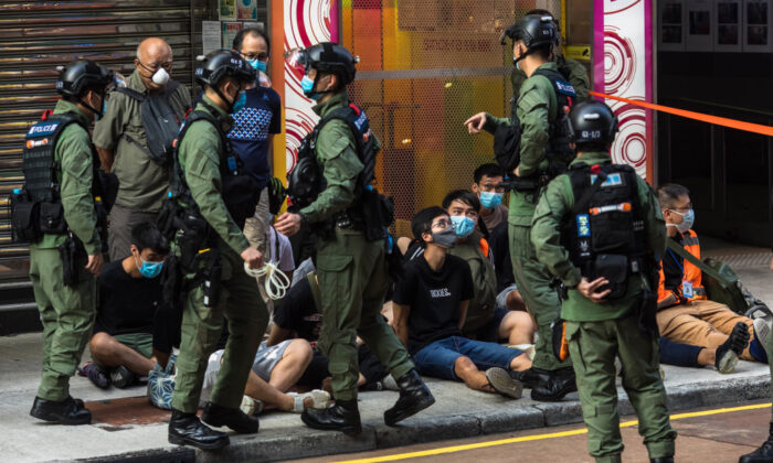Police detain people as they patrol the area after protesters called for a rally in Hong Kong on Sept. 6, 2020. (Dale De Lay Rey/AFP via Getty Images)