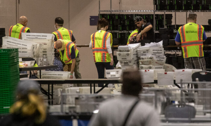Election workers count ballots at the Philadelphia Convention Center in Philadelphia, Pa., on Nov. 6, 2020. (Chris McGrath/Getty Images)