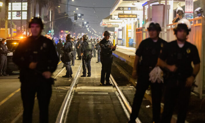 Police stand at the Blue Line station in downtown Los Angeles, where protesters blocked the track on Nov. 3, 2020. (John Fredricks/The Epoch Times)