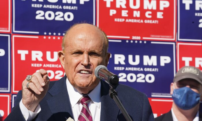 Attorney for the president Rudy Giuliani speaks at a news conference in the parking lot of a landscaping company in Philadelphia on Nov. 7, 2020. (Bryan R. Smith/AFP via Getty Images)