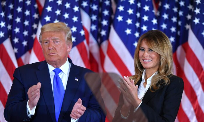 President Donald Trump claps alongside First Lady Melania Trump after speaking in the East Room of the White House in Washington, early on Nov. 4, 2020. (Mandel Ngan/AFP via Getty Images)