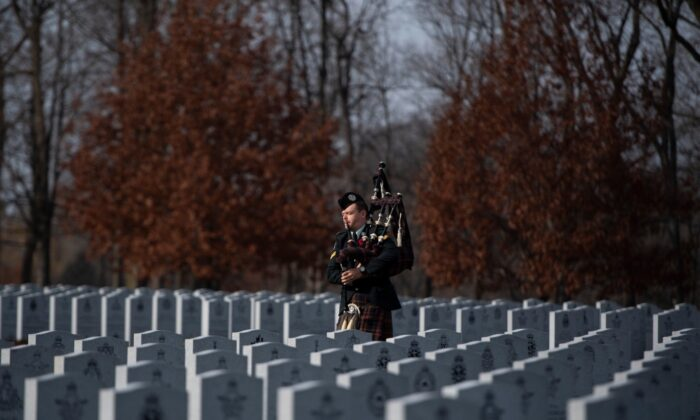 A piper prepares for an internment ceremony at the National Military Cemetery in Ottawa on Nov. 7, 2020. (The Canadian Press/Justin Tang)