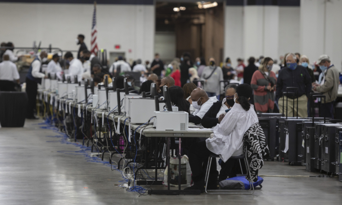 Workers with the Detroit Department of Elections help process absentee ballots at the Central Counting Board in the TCF Center in Detroit, Mich., on Nov. 4, 2020. (Elaine Cromie/Getty Images)