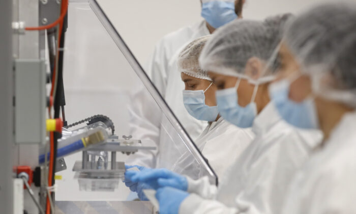 Employees at Spectrum Solutions prepare COVID-19 saliva test kits for shipment in Draper, Utah, on Sept. 21, 2020. (George Frey/Getty Images)