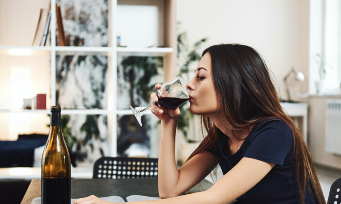 """The messaging around alcohol, or """"mommy juice,"""" has been detrimental to mothers. Instead, they need connection and support. (Friends Stock/Shutterstock)"""