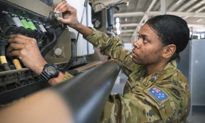 3rd Combat Service Support Battalion Driver Specialist Private Pamela Amber conducts an inspection on an Australian Army MAN HX77 vehicle at Lavarack Barracks, Townsville. (PTE Madhur Chitnis via ADF)
