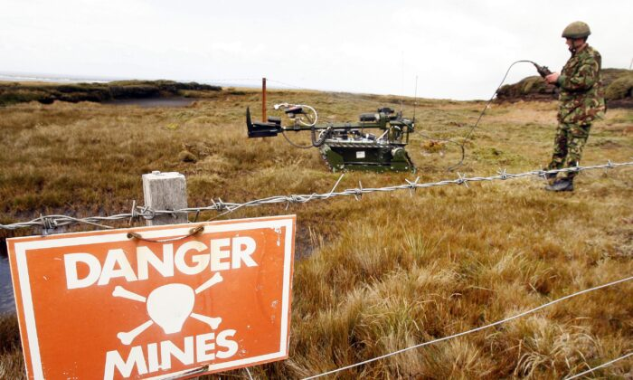 "A Joint Service Explosive Ordnance Disposal robot ""Red Fire"" is prepared to recover a mine in Stanley, Falkland Islands, on Feb. 9, 2007. (Peter Macdiarmid/Getty Images)"