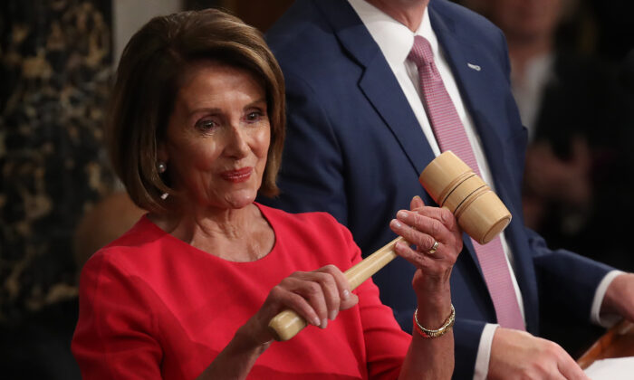 Speaker of the House Nancy Pelosi (D-Calif.) smiles after receiving the gavel from Rep. Kevin McCarthy (R-Calif.) after being elected as the next Speaker of the House during the first session of the 116th Congress at the U.S. Capitol in Washington on Jan. 3, 2019. (Win McNamee/Getty Images)