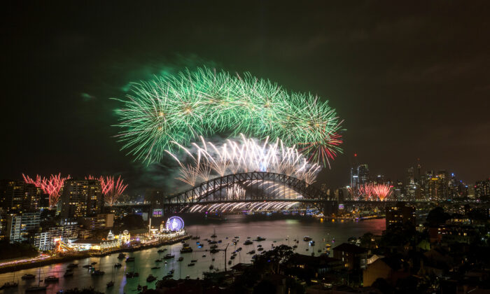 Fireworks light up the sky above Sydney Harbour during the midnight fireworks display during New Year's Eve celebrations on January 1st, 2020 (Cameron Spencer/Getty Images)