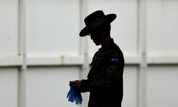 A member of the Defence Force at Sydney Airport, Australia on March 30, 2020. (Brendon Thorne/Getty Images)