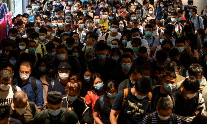 Passengers arrive at Pudong International Airport in Shanghai, China on Sept. 29, 2020. (HECTOR RETAMAL/AFP via Getty Images)