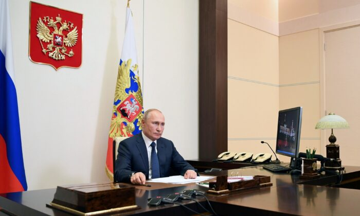 Russian President Vladimir Putin speaks on the signed deal on a complete stoppage of combat actions over the Nagorno-Karabakh region at the Novo-Ogaryovo state residence outside Moscow, Russia, on Nov. 10, 2020. (Sputnik/Aleksey Nikolskyi/Kremlin via Reuters)