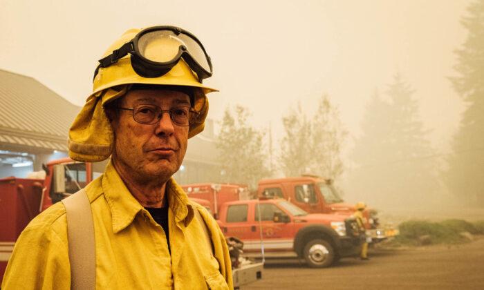 Volunteer firefighter Bruce Brunstad poses in Gates, Ore., on Sept. 10, 2020. Benjamin Franklin founded the first all-volunteer fire department in the United States. (KATHRYN ELSESSER/AFP via Getty Images)