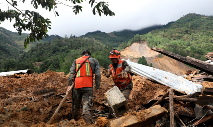Soldiers work at an area hit by a mudslide, caused by heavy rains brought by Storm Eta, as the search for victims continue in the buried village of Queja, Alta Verapaz, Guatemala Nov. 7, 2020. (Esteban Bilba/EFE/Pool via Reuters)
