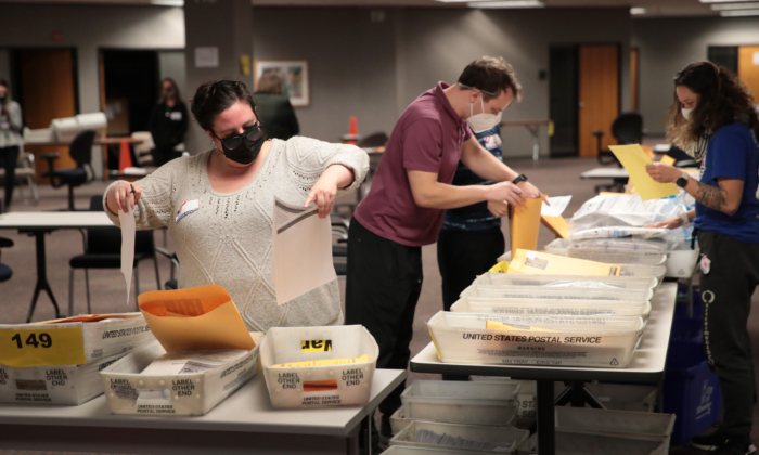 Election officials count absentee ballots on Nov. 4, 2020, in Milwaukee. (Scott Olson/Getty Images)