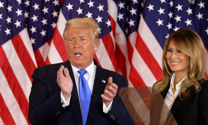 President Donald Trump and First Lady Melania Trump take the stage on election night in the East Room of the White House in Washington early Nov. 4, 2020. (Chip Somodevilla/Getty Images)