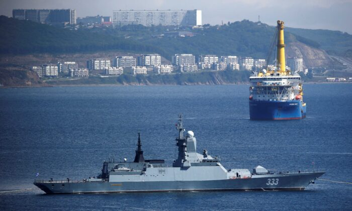 The Russian navy corvette Sovershenny and the Gazprom owned pipe-laying ship Akademik Cherskiy are seen offshore Vladivostok, Russia, on Sept. 6, 2017. (Sergei Karpukhin/Reuters)
