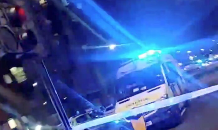 A police car is seen after an incident at Edmonton Police station in London, Britain November 11, 2020, (Credit: this still image obtained from a social media video. Twitter @chechiok/via REUTERS)