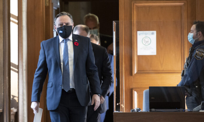 Quebec Premier Francois Legault walks to a news conference on the COVID-19 pandemic at the legislature in Quebec City on Nov. 5, 2020. (Jacques Boissinot/The Canadian Press)