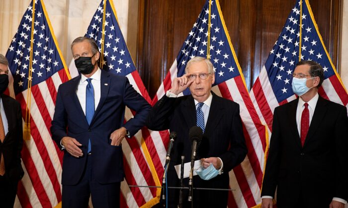 (L-R) Sens. Roy Blunt (R-Mo.), John Thune (R-S.D.), Majority Leader Mitch McConnell (R-Ky.) and John Barrasso (R-Wyo.) speak to the media at the U.S. Capitol in Washington, on Nov. 10, 2020. (Tasos Katopodis/Getty Images)