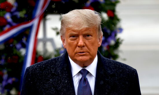 Trump Pays Tribute to Veterans in the Rain at Arlington National Cemetery