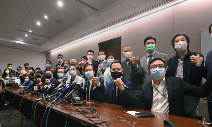 Lawmakers of Hong Kong's pro-democracy camp hold a press conference in Hong Kong on Nov. 11, 2020. (Song Bilung/The Epoch Times)