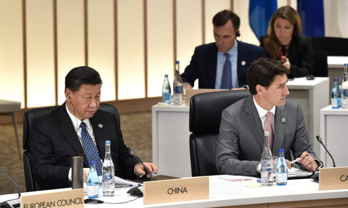 Chinese leader Xi Jinping (L) and Canada's Prime Minister Justin Trudeau attend a session at the G20 Summit in Osaka, Japan, on June 29, 2019. (Kazuhiro Nogi/Pool via Reuters)