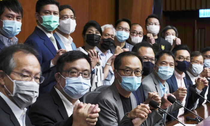 Hong Kong's pro-democracy legislators pose a picture before a press conference at the Legislative Council in Hong Kong on Nov. 9, 2020. (Vincent Yu/AP Photo)