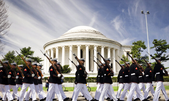 The Marine Corps Silent Drill Platoon marches in front of the Thomas Jefferson Memorial on its way to perform for the Cherry Blossom Festival in Washington April 12, 2014. (U.S. Marine Corps photo by Sgt. Bryan Nygaard/Released)