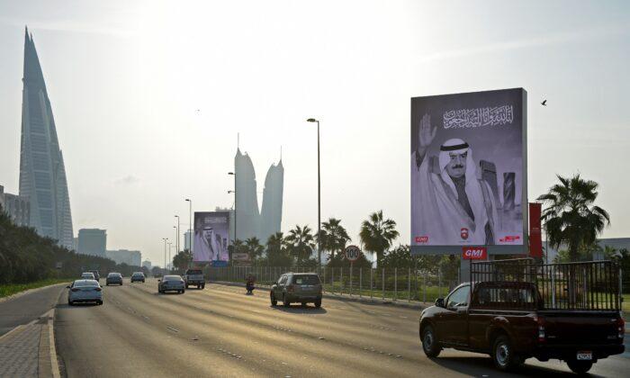 Cars drive on a highway past large posters of the late prince Khalifa bin Salman al-Khalifa, in the Bahraini capital Manama, Khalifa, on Nov. 11, 2020. (Mazen Mahdi/AFP via Getty Images)