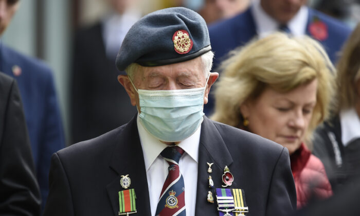 Veterans observe a 2-minute silence for Armistice day in remembrance of the nations war dead on Nov. 11, 2020, at the Cenotaph in London. (Daniel Leal-Olivas/AFP)