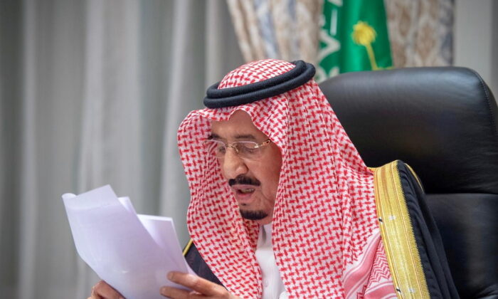 Saudi King Salman bin Abdulaziz gives a speech during the first session of the Shura council, from his palace in NEOM, Saudi Arabia, on Nov. 11, 2020. (Bandar Algaloud/Courtesy of Saudi Royal Court/Handout via Reuters)