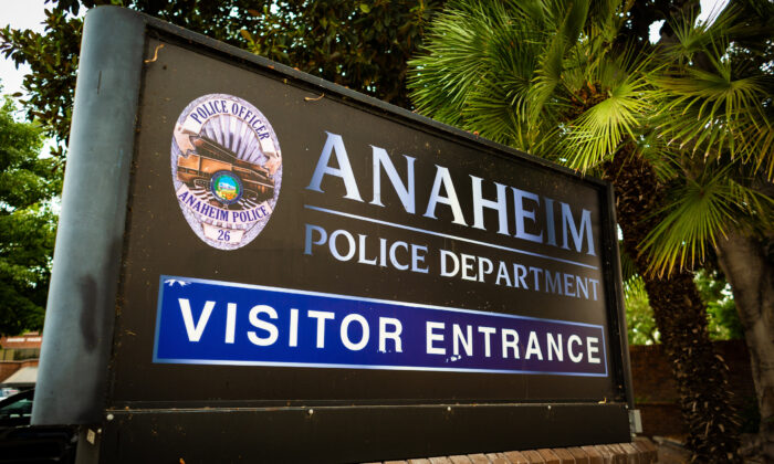 A sign points the way to the Anaheim Police Department visitor entrance in Anaheim, Calif., on Sept. 10, 2020. (John Fredricks/The Epoch Times)