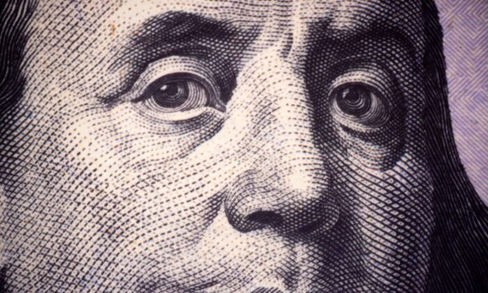 A close-up photo of Benjamin Franklin, one of the founding fathers of the United States, as seen on a U.S. $100 Federal Reserve Note on Nov. 17, 2015 (Paul J. Richards/AFP via Getty Images)